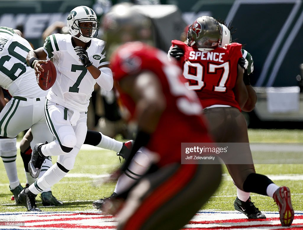 Geno Smith #7 of the New York Jets scrambles against the Tampa Bay Buccaneers during their game at MetLife Stadium on September 8, 2013 in East Rutherford, New Jersey.