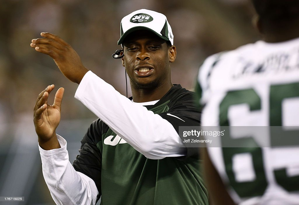 Geno Smith #7 of the New York Jets stands on the sidelines during their preseason game against the Jacksonville Jaguars at MetLife Stadium on August 17, 2013 in East Rutherford, New Jersey.