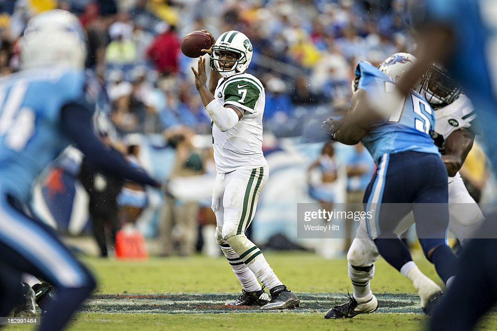 <a gi-track='captionPersonalityLinkClicked' href=/galleries/search?phrase=Geno+Smith&family=editorial&specificpeople=6379793 ng-click='$event.stopPropagation()'>Geno Smith</a> #7 of the New York Jets throws a pass against the Tennessee Titans and fumbles the football at LP Field on September 29, 2013 in Nashville, Tennessee. The Titans defeated the Jets 38-13.
