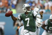 Geno Smith of the New York Jets throws the ball against the Miami Dolphins on December 29 2013 at Sun Life Stadium in Miami Gardens Florida The Jets...