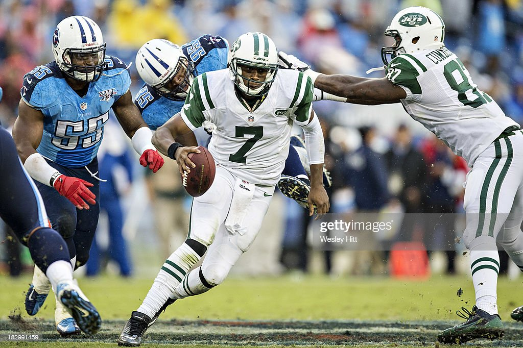 <a gi-track='captionPersonalityLinkClicked' href=/galleries/search?phrase=Geno+Smith&family=editorial&specificpeople=6379793 ng-click='$event.stopPropagation()'>Geno Smith</a> #7 of the New York Jets tries to avoid the rush from <a gi-track='captionPersonalityLinkClicked' href=/galleries/search?phrase=Kamerion+Wimbley&family=editorial&specificpeople=627718 ng-click='$event.stopPropagation()'>Kamerion Wimbley</a> #95 and <a gi-track='captionPersonalityLinkClicked' href=/galleries/search?phrase=Zach+Brown+-+American+Football+Player&family=editorial&specificpeople=6705522 ng-click='$event.stopPropagation()'>Zach Brown</a> #55 of the Tennessee Titans at LP Field on September 29, 2013 in Nashville, Tennessee. The Titans defeated the Jets 38-13.