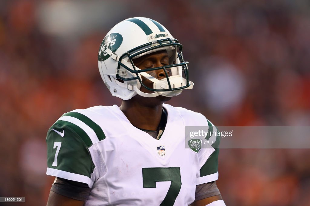 <a gi-track='captionPersonalityLinkClicked' href=/galleries/search?phrase=Geno+Smith&family=editorial&specificpeople=6379793 ng-click='$event.stopPropagation()'>Geno Smith</a> #7 of the New York Jets walks off of the field in the 4th quarter after throwing an interception and having it returned for a touchdown during the NFL game against the Cincinnati Bengals at Paul Brown Stadium on October 27, 2013 in Cincinnati, Ohio.