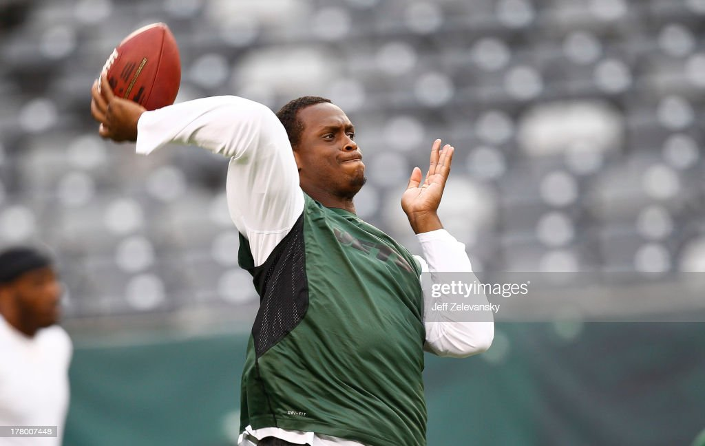 Geno Smith #7 of the New York Jets warms up before their game against the Jacksonville Jaguars at MetLife Stadium on August 17, 2013 in East Rutherford, New Jersey.