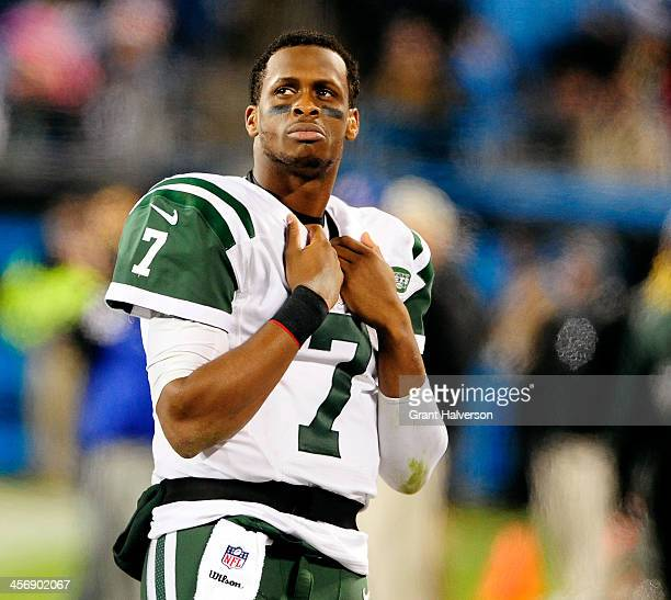 Geno Smith of the New York Jets watches the scoreboard during the final minute of a loss to the Carolina Panthers at Bank of America Stadium on...