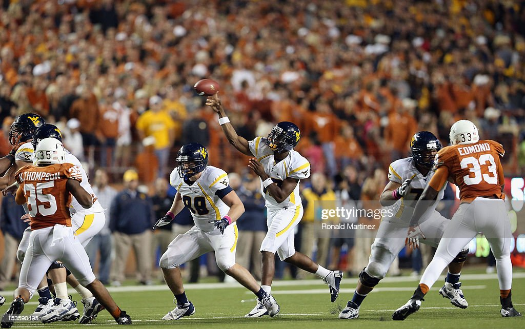 Geno Smith #12 of the West Virginia Mountaineers throws the ball against the Texas Longhorns at Darrell K Royal-Texas Memorial Stadium on October 6, 2012 in Austin, Texas.