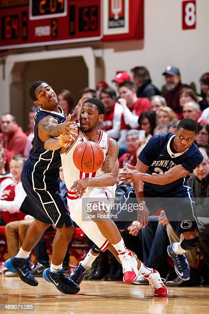 Geno Thorpe and Tim Frazier of the Penn State Nittany Lions defend against Evan Gordon of the Indiana Hoosiers during the game at Assembly Hall on...