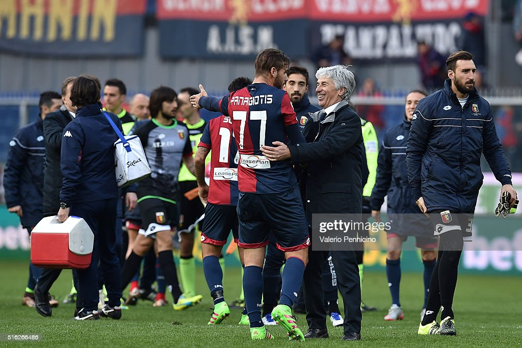 Genoa CFC head coach <a gi-track='captionPersonalityLinkClicked' href=/galleries/search?phrase=Gian+Piero+Gasperini&family=editorial&specificpeople=4667555 ng-click='$event.stopPropagation()'>Gian Piero Gasperini</a> (R) celebrates victory with <a gi-track='captionPersonalityLinkClicked' href=/galleries/search?phrase=Panagiotis+Tachtsidis&family=editorial&specificpeople=6240627 ng-click='$event.stopPropagation()'>Panagiotis Tachtsidis</a> at the end of the Serie A match between Genoa CFC and Torino FC at Stadio Luigi Ferraris on March 13, 2016 in Genoa, Italy.