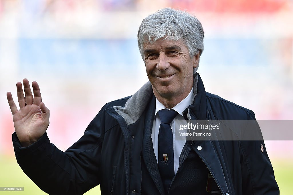 Genoa CFC head coach <a gi-track='captionPersonalityLinkClicked' href=/galleries/search?phrase=Gian+Piero+Gasperini&family=editorial&specificpeople=4667555 ng-click='$event.stopPropagation()'>Gian Piero Gasperini</a> salutes the fans during the Serie A match between Genoa CFC and Torino FC at Stadio Luigi Ferraris on March 13, 2016 in Genoa, Italy.