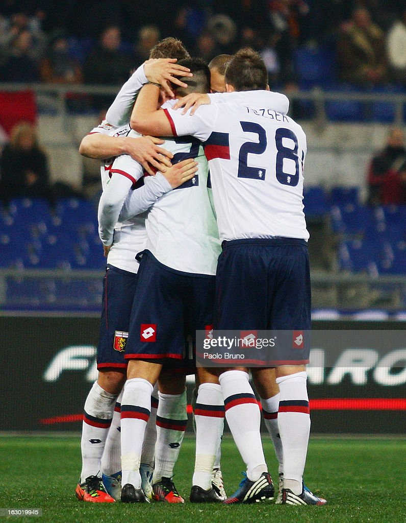 Genoa CFC players celebrate the first team's goal scored by Marco Borriello during the Serie A match between AS Roma and Genoa CFC at Stadio Olimpico on March 3, 2013 in Rome, Italy.