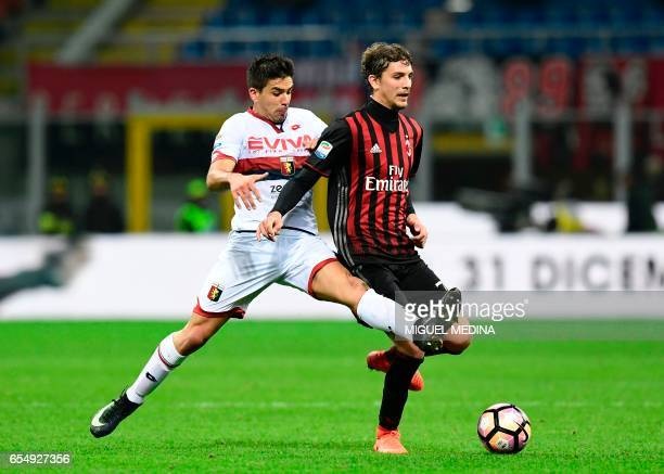 Genoa's Argentinian forward Giovanni Simeone tackles AC Milan's Italian midfielder Manuel Locatelli during the Italian Serie A football match AC...