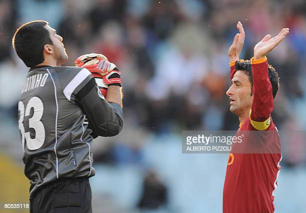 Genoa's Brazilian goalkeeper Rubens Fernando M Rubinho stops the ball in front of AS Roma's defender Chistian Panucci during AS Roma vs Genoa Italian...