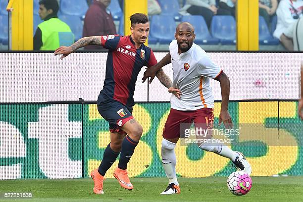 Genoa's defender from Italy Armando Izzo fights for the ball with Roma's defender from Brazil Maicon during the Italian Serie A football match Genoa...