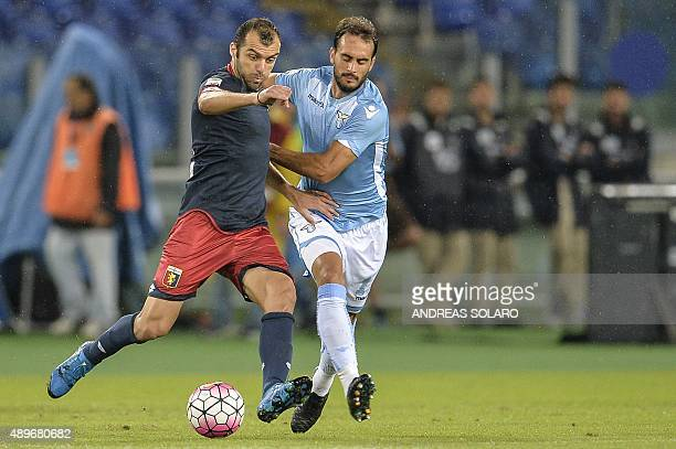 Genoa's forward from Macedonia Goran Pandev fights for the ball with Lazio's defender from Argentina Santiago Gentiletti during the Italian Serie A...
