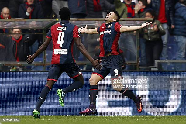 Genoa's forward Giovanni Simeone celebrates with his teammate Genoa's Ghanian midfielder Isaac Cofie after scoring during the Italian Serie A...