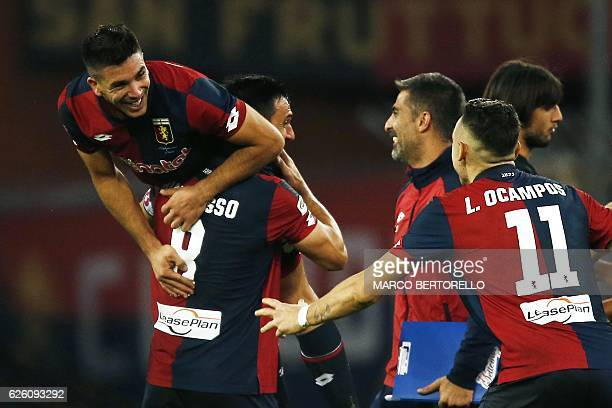 Genoa's forward Giovanni Simeone celebrates with his teammates after scoring during the Italian Serie A football match Genoa Vs Juventus on November...