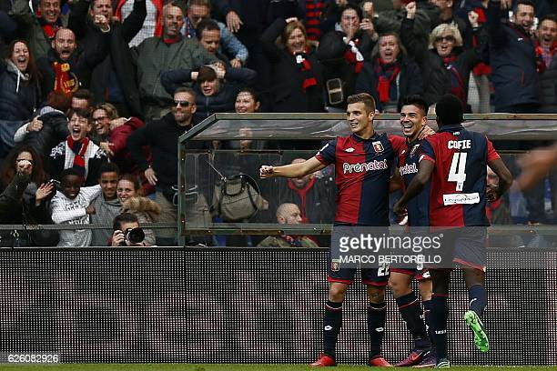 Genoa's forward Giovanni Simeone celebrates with teammates after scoring a goal during the Italian Serie A football match between Genoa and Juventus...