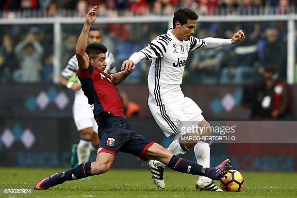 Genoa's forward Giovanni Simeone vies for the ball with Juventus' Brazilian midfielder Anderson Hernanes during the Italian Serie A football match...