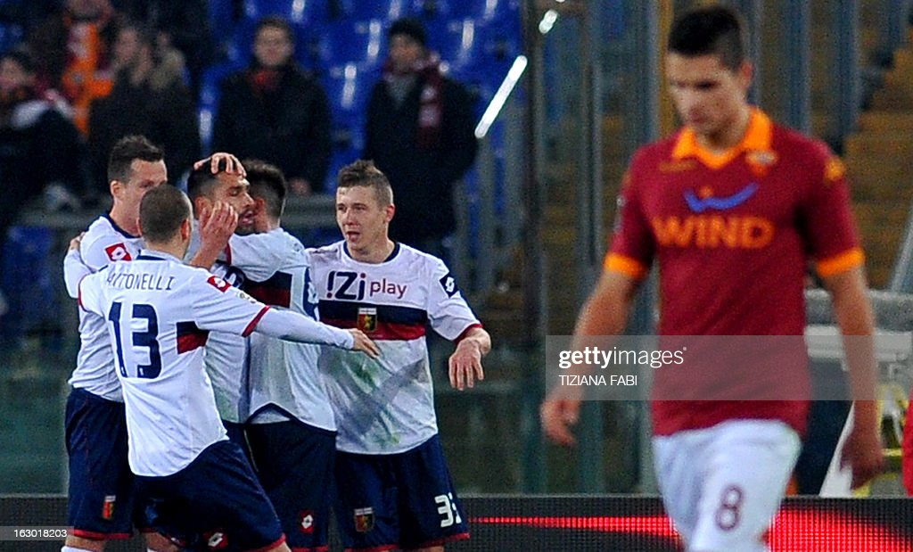 Genoa's forward Marco Borriello (3rd L) celebrates with teammates after scoring a penalty against Roma during the Italian Serie A football match AS Roma vs Genoa at Olympic Stadium in Rome on March 3, 2013. AFP PHOTO / TIZIANA FABI