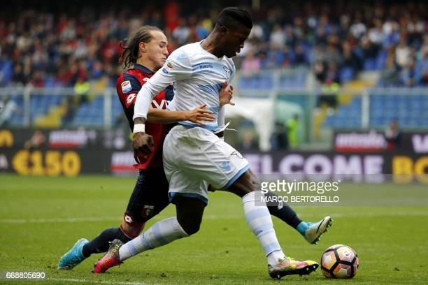 Genoa's midfielder Diego Laxalt from Uruguay fights for the ball with Lazio's forward Keita Balde Diao from Spain during the Italian Serie A football...