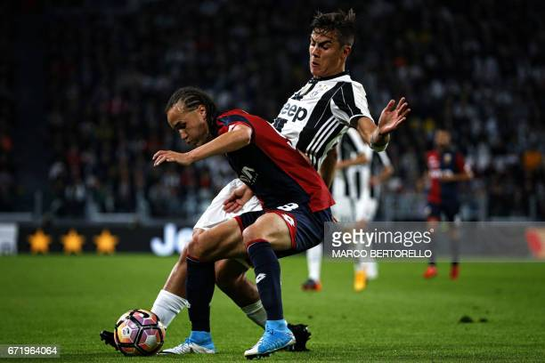 Genoa's midfielder Diego Laxalt from Uruguay fights for the ball with Juventus' forward Paulo Dybala from Argentina during the Italian Serie A...
