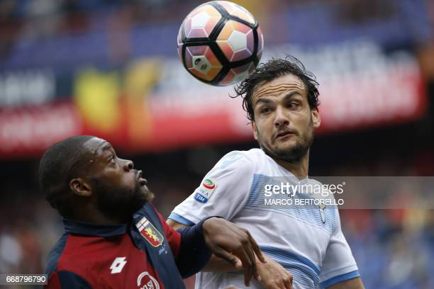 Genoa's midfielder Olivier Ntcham from France fights for the ball with Lazio's midfielder Marco Parolo during the Italian Serie A football match...