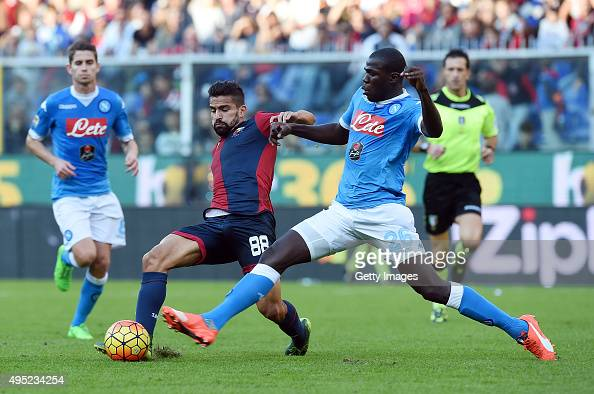 Genoa's player Thomas Rincon vies with Napoli player Kalidou Koulibaly during the Serie A match between Genoa CFC and SSC Napoli at Stadio Luigi...