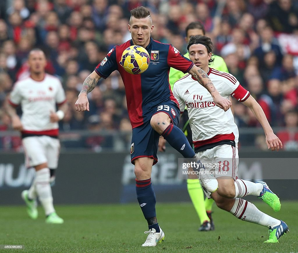 Genoa's Slovakian forward Juraj Kucka fights for the ball with AC Milan's midfielder Riccardo Montolivo during the Italian Serie A football match...