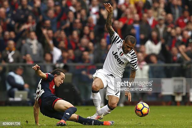 Genoa's Uruguayan midfielder Diego Laxalt challenges Juventus' Brazilian defender Daniel Alves during the Italian Serie A football match between...