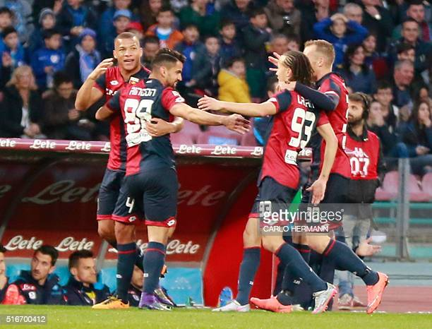 Genoa's Venezuelan midfielder Tomas Rincon celebrates with teammates after scoring during the Italian Serie A football match SSC Napoli vs Genoa CFC...