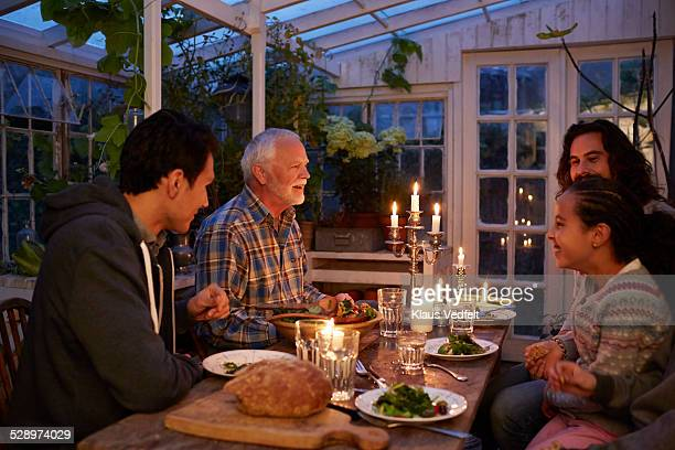 3 genorations at cozy dinner in garden house