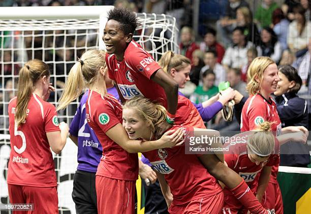Genoveva Anonma and Tabea Kemme of 1FFC Turbine Potsdam 1971 celebrate winning during the DFB Women's Indoor Cup 2013 final between 1FFC Turbine...