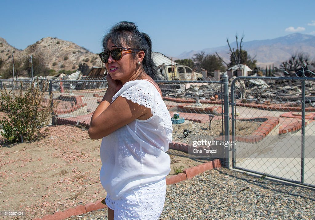 Genoveva Gibson of South Lake is emotional after coming back to her destroyed home for the first time where her 4 dogs perished on June 27, 2016 in South Lake, California. Gibson said she saw some smoke from the fire on Thursday, left to get water at the store and left her dogs in the yard. When she returned, the fire was so bad she could not get back to her home to rescue her dogs.