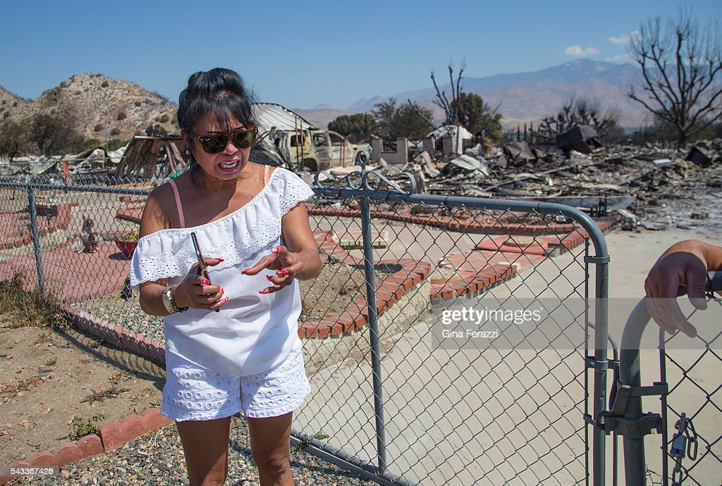 Genoveva Gibson of South Lake is very emotional after coming back to her destroyed home for the first time where her 4 dogs perished on June 27, 2016 in South Lake, California. Gibson said she saw some smoke from the fire on Thursday, left to get water at the store and left her dogs in the yard. When she returned, the fire was so bad she could not get back to her home to rescue her dogs.(