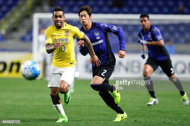 Genta Miura of Gamba Osaka and Alex Teixeira of Jiangsu Suning compete for the ball during the AFC Champions League Group H match between Gamba Osaka...