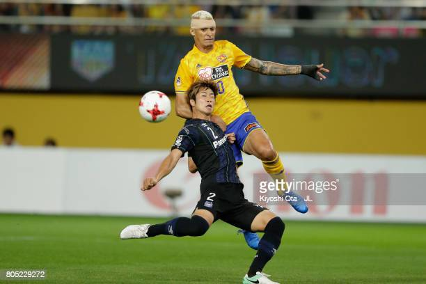 Genta Miura of Gamba Osaka and Crislan of Vegalta Sendai compete for the ball during the JLeague J1 match between Vegalta Sendai and Gamba Osaka at...