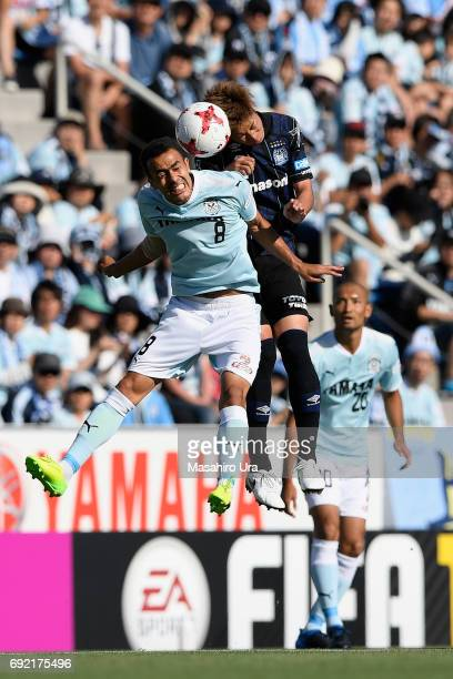 Genta Miura of Gamba Osaka and Fozil Musaev of Jubilo Iwata compete for the ball during the JLeague J1 match between Jubilo Iwata and Gamba Osaka at...
