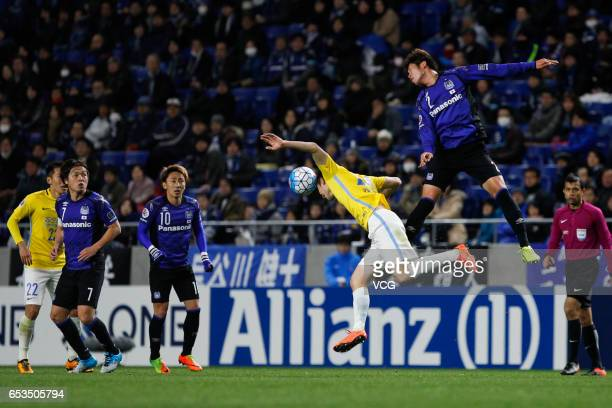 Genta Miura of Gamba Osaka and Ji Xiang of Jiangsu Suning compete for the ball during the AFC Champions League Group H match between Gamba Osaka and...