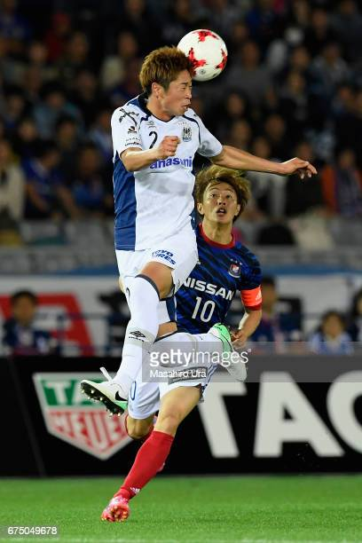 Genta Miura of Gamba Osaka and Manabu Saito of Yokohama FMarinos compete for the ball during the JLeague J1 match between Yokohama FMarinos and Gamba...