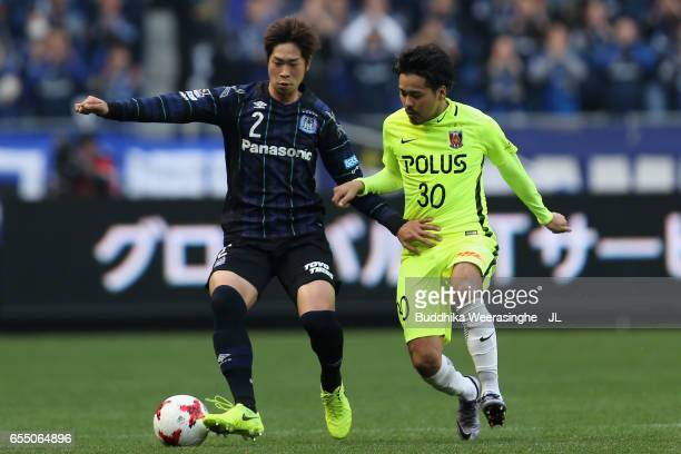 Genta Miura of Gamba Osaka and Shinzo Koroki of Urawa Red Diamonds compete for the ball during the JLeague J1 match between Gamba Osaka and Urawa Red...