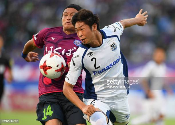 Genta Miura of Gamba Osaka and Yusuke Tanaka of Ventforet Kofu compete for the ball during the JLeague J1 match between Ventforet Kofu and Gamba...