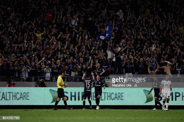 Genta Miura of Gamba Osaka celebrates scoring his side's second goal with his team mate Yasuyuki Konno during the JLeague J1 match between Gamba...