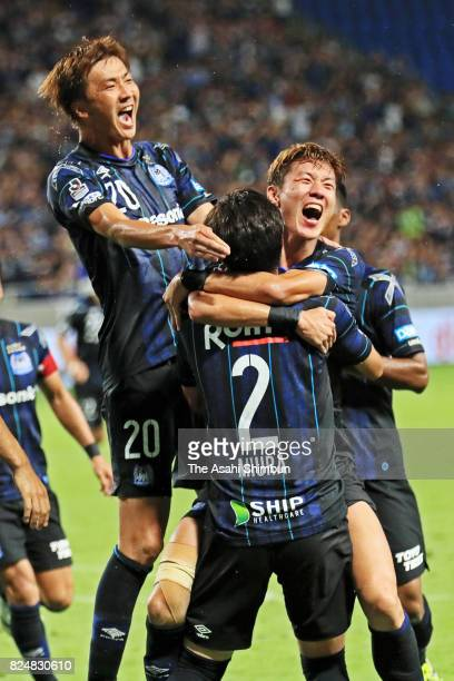 Genta Miura of Gamba Osaka celebrates scoring his side's second goal with his team mates during the JLeague J1 match between Gamba Osaka and Cerezo...