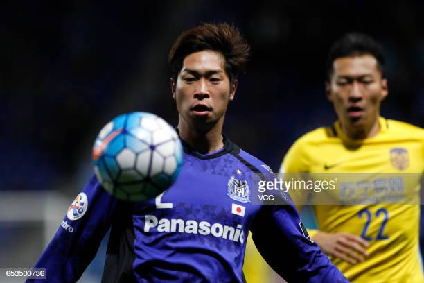 Genta Miura of Gamba Osaka handles the ball during the AFC Champions League Group H match between Gamba Osaka and Jiangsu Suning at the Suita City...