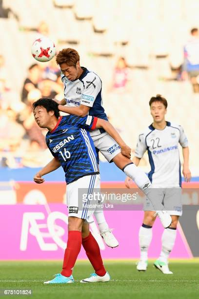 Genta Miura of Gamba Osaka outjumps Sho Ito of Yokohama FMarinos during the JLeague J1 match between Yokohama FMarinos and Gamba Osaka at Nissan...