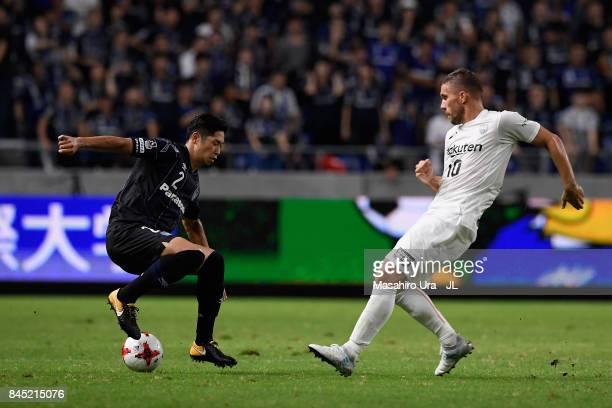 Genta Miura of Gamba Osaka takes on Lukas Podolski of Vissel Kobe during the JLeague J1 match between Gamba Osaka and Vissel Kobe at Suita City...