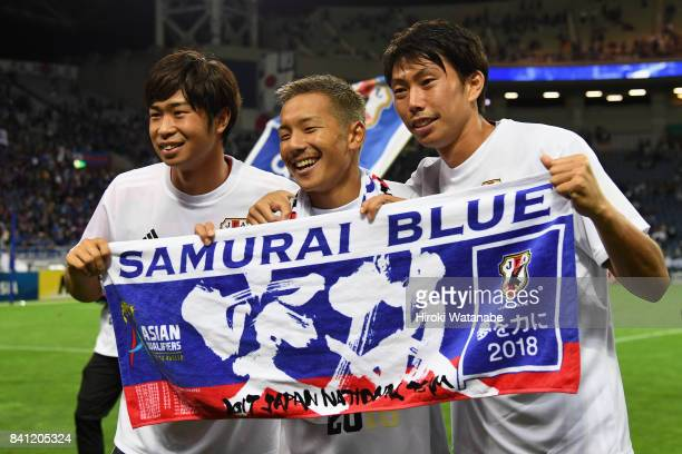 Genta Miura Yosuke Ideguchi and Masaaki Higashiguchi of Japan applaud supporters after their 20 victory and qualified for the FIFA World Cup Russia...