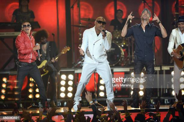 Gente de Zona and Enrique Iglesias perform onstage during the 2014 Billboard Latin Music Awards at Bank United Center on April 24 2014 in Miami...