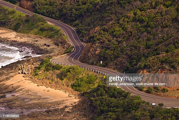Gentle curved road follows coast line