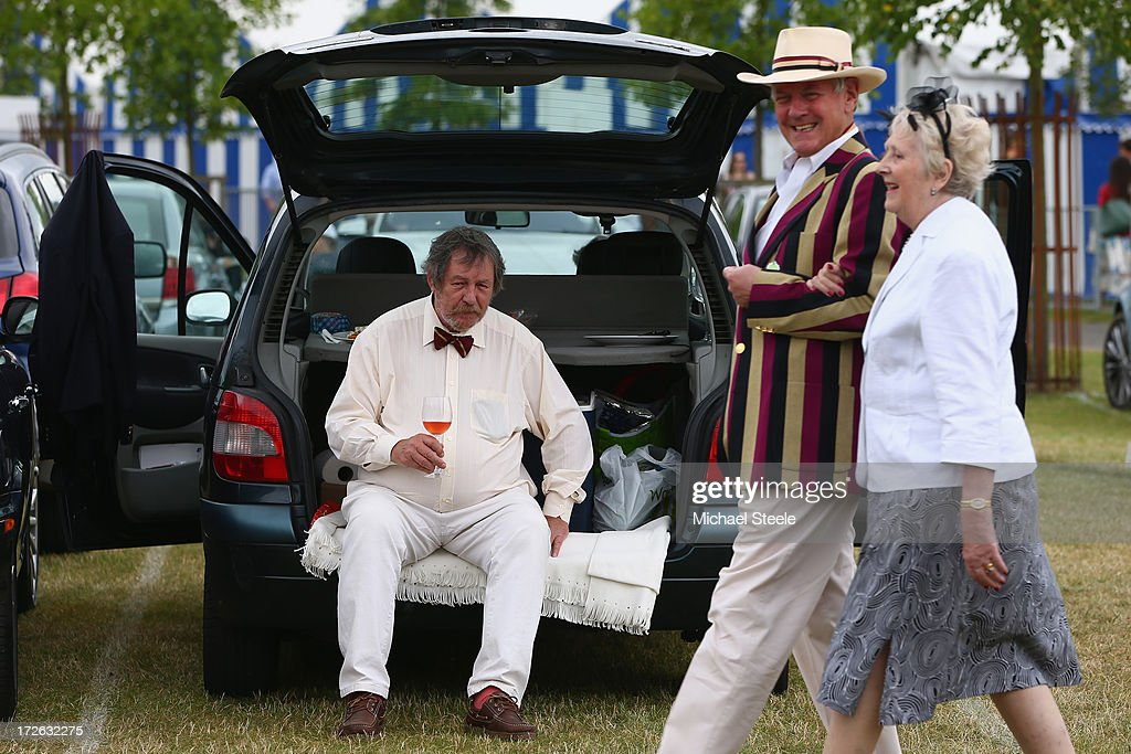 A gentleman enjoys a glass of rose in the car park area during day two of the Hnley Royal Regatta on July 4, 2013 in Henley-on-Thames, England.