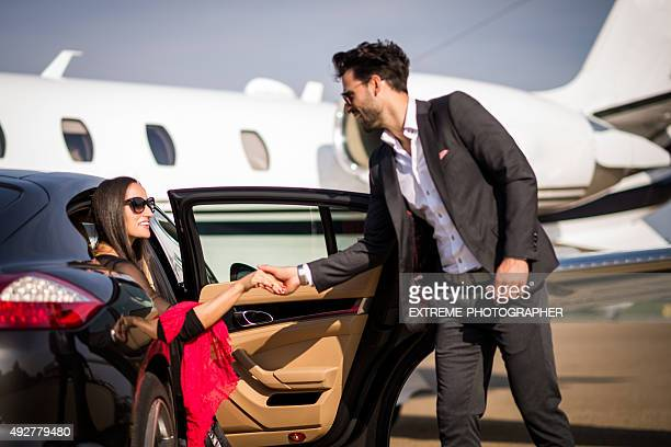 Gentleman helping woman to exit the vehicle